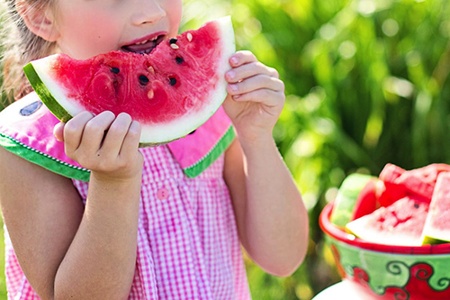 8image of a little girl eating a watermelon