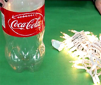 image of a 2l coke bottle and fairy lights