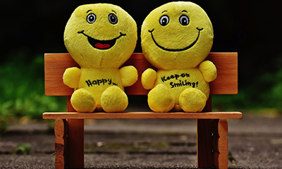 image of two happy people on bench